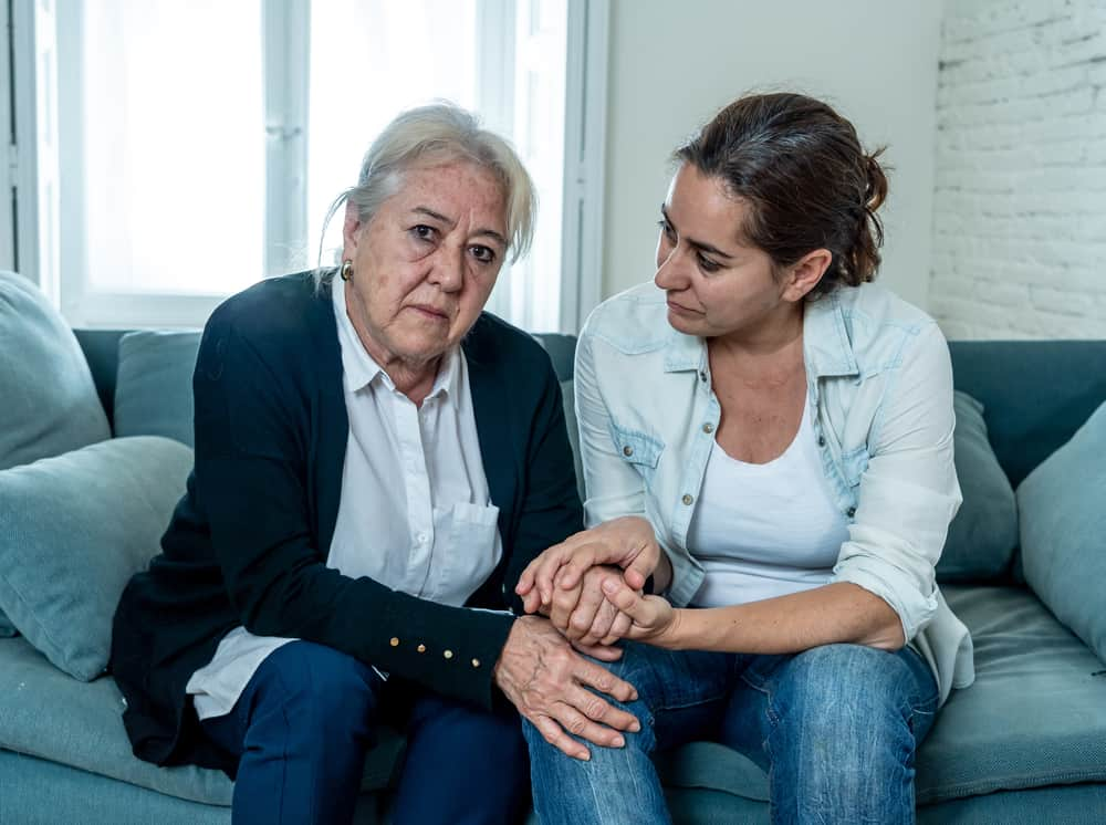 Depressed divorced woman being comforted by a family law attorney